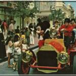 "Riding down Main Street USA: Mickey Mouse joins guests aboard a ""new-fangled"" chugging Fire Engine for a ride down Main Street, where turn-of-the-century America is recreated."