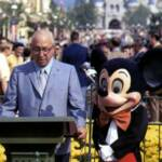 Cast Member Doug Parks as Mickey Mouse standing alongside Roy O. Disney on October 25, 1971.
